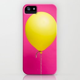 Yellow balloon on pink backdrop iPhone Case