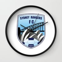 fire emblem Wall Clocks featuring Emblem by Sydney Rangers FC