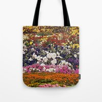 the neighbourhood Tote Bags featuring Some neighbourhood called flower by Martin Carri