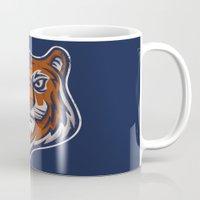shield Mugs featuring Tiger Shield by WanderingBert / David Creighton-Pester