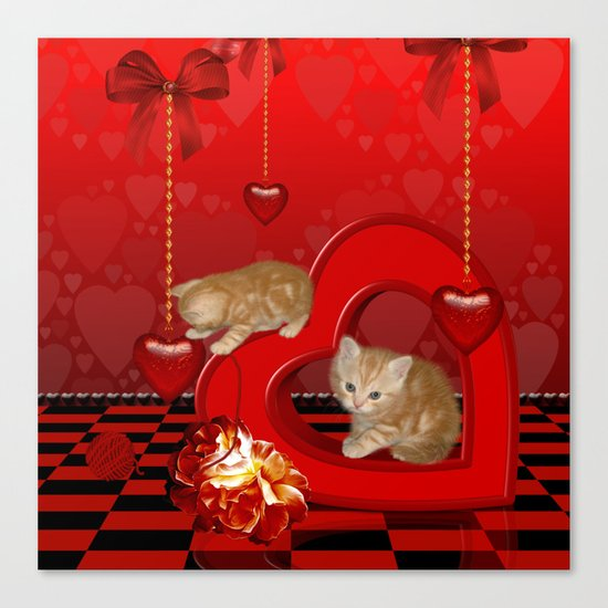 Cute, playing kitten Canvas Print