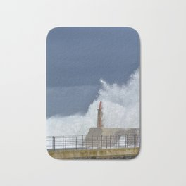 Stormy wave over old lighthouse Bath Mat