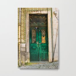 Old wooden door secured with chain and padlock. Wall with profusely decorated tiles. Metal Print