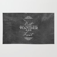 not all who wander Area & Throw Rugs featuring Wander by Fancy Designs