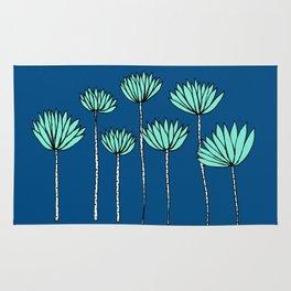Blue and Teal Tropical Botanical Print by Emma Freeman Designs Rug