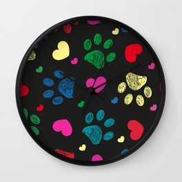 Doodle colorful paw prints with hearts seamless fabric design pattern vector black background Wall Clock