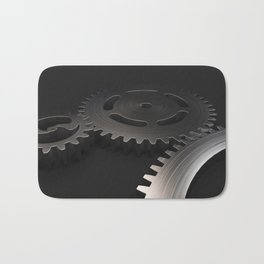 Set of metal gears and cogs on black Bath Mat