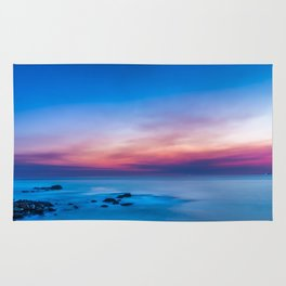 Sunset long exposure over the ocean Rug
