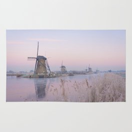 Pastel sunrise over windmills in winter in the Netherlands Rug