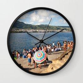 People waiting at the islet Wall Clock