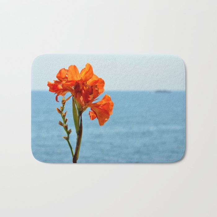 Flower and sea. Blooming beacon Bath Mat
