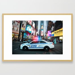 NYPD police squad car goes to emergency call with alarm and siren light in the Time Square streets o Framed Art Print