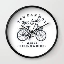 You can not be sad while riding a bike Wall Clock