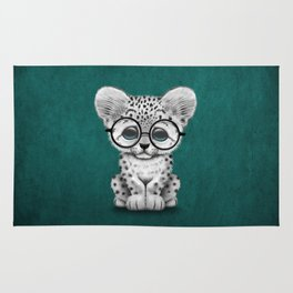 Cute Snow Leopard Cub Wearing Glasses on Teal Blue Rug