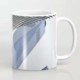 Towering Over Coffee Mug