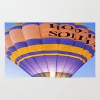 hot air balloon Area & Throw Rugs featuring Flaming Hot Air Balloon by Brian Raggatt