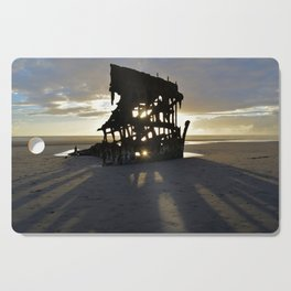 Wreck of the Peter Iredale at sunset Cutting Board