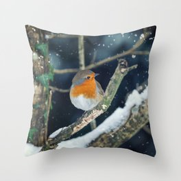 Robin perched in a tree with falling snow around Throw Pillow