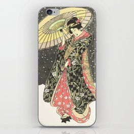 In the snow with an umbrella iPhone Skin
