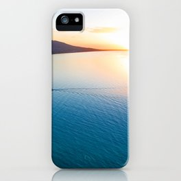 Small boat approaching a wooden pier at scenic sunset iPhone Case