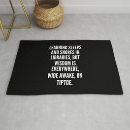 Learning sleeps and snores in libraries but wisdom is everywhere wide awake on tiptoe Rug