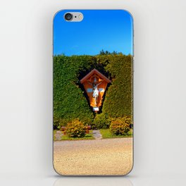 Jesus, a cross and a trimmed bush iPhone Skin