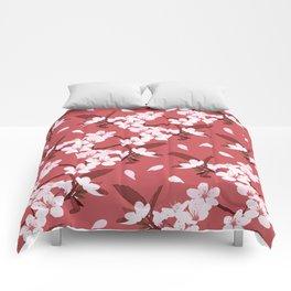 Sakura on red background Comforters
