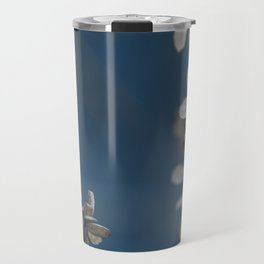 White Floral Pattern Against Blue Background Travel Mug