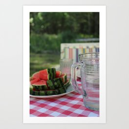 Watermelon and water carafe on garden table Art Print