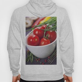 Tomatoes, chives and vegetables on a table Hoody