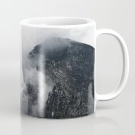 White clouds over the dark rocky mountains Coffee Mug
