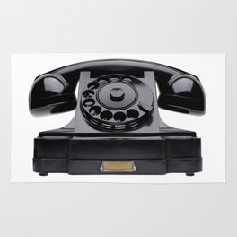Old black telephone, middle of 20th century, aged and scuffed Rug