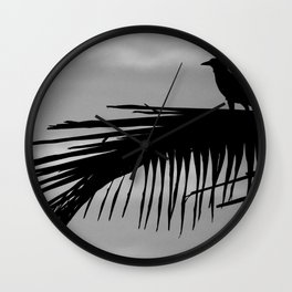 Bird silhouette with palm tree leaf in the Caribbean Wall Clock