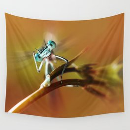 Blue dragonfly on pink flower Wall Tapestry