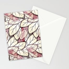 Delicate openwork leaves on a white , light brown background. Stationery Cards