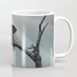 elephant and dog sit on a tree during a flood Coffee Mug
