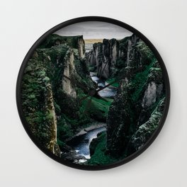 Fast flowing river making (wending) it's way between two massive rock formations Wall Clock