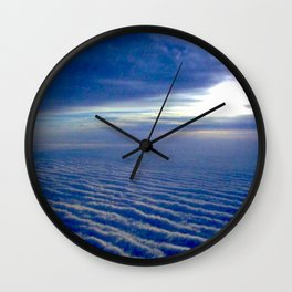 looking down on a sunrise cloud carpet Wall Clock