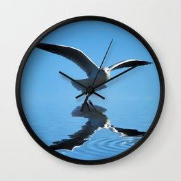 Seagull on blue sky Wall Clock
