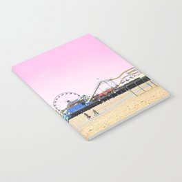 Santa Monica Pier with Ferries Wheel and Roller Coaster Against a Pink Sky Notebook