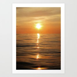 Sun setting over calm waters Art Print