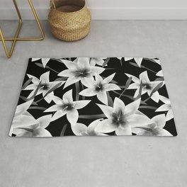 White lilies on a black background . Rug