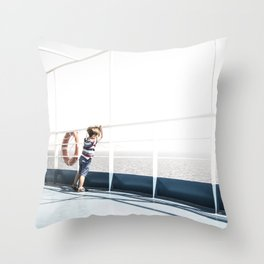 Child staring at the sea Throw Pillow
