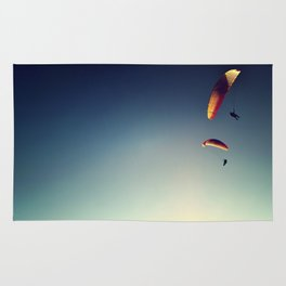 two paragliders from above Rug