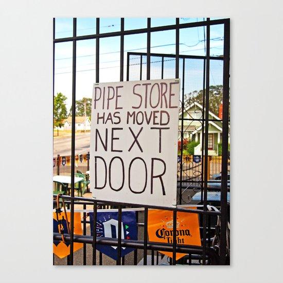 Pipe store next door Canvas Print