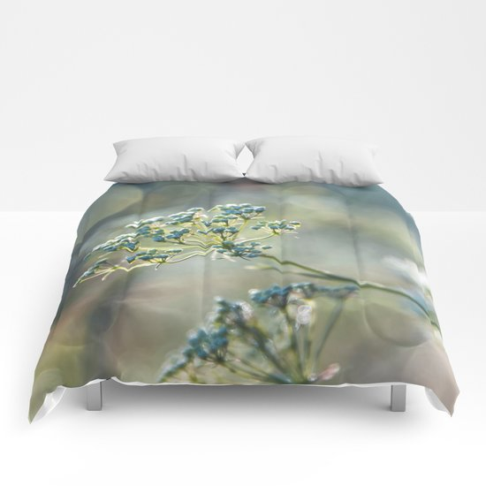 Early morninglight in a meadow Comforters