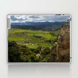 Cliffs in the city of Ronda, Spain. View of the field covered with clouds. Laptop & iPad Skin