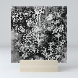 bees fill honeycombs in hive splatter watercolor black white Mini Art Print