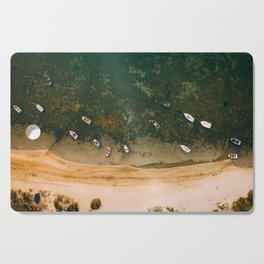 Aerial view of a Lagoon with boats Cutting Board