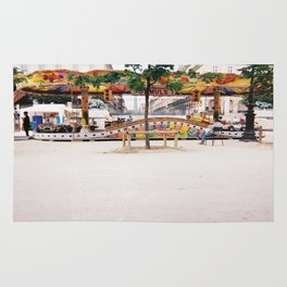 Photograph of Paris summer fair outside of St Honore Hotel society6 zolliophone shop Rug